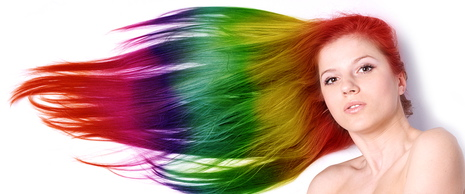 Portraot of a beautiful woman with long color hair
